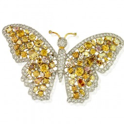 Butterfly Brooch - (100) Natural Color Diamonds, 8.25ctw. With (100) Diamond Accents, 2.47ctw. Made in Platinum. Weighs 37.25g.