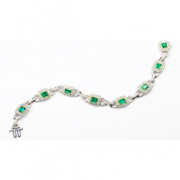 8-3.64 Emerald Cut Emerald Bracelet set with 472-3.66 White Melee Round Diamonds. Set in 18KWG & 18KYG with 25.57 grms.
