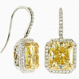 A Radiant 3.01ct Fancy Yellow VS1 and 2.84ct Fancy Yellow IF Diamond Earrings set