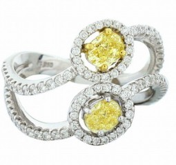0.48ct oval shaped fancy intense yellow diamond. 0.41ct oval shaped fancy intense yellow diamond. With white diamond pavC), 0.67ctw. Made in platinum.