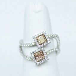 0.38ct Radiant Shaped (Fancy) Pink Diamond. 0.37ct Radiant Shaped (Fancy Light) Yellowish Green Diamond. With 90 F-G VS Accent Diamonds, 0.93ctw. Made in Platinum and 18K Gold.