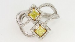 (2) Radiant Shaped (Fancy Intense) Greenish Yellow Diamonds, 0.69ctw. With 89 F-G VS Accent Diamonds, 0.86ctw. Made in Platinum and 18K Gold.