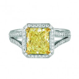 2.88ct Emerald Shaped Fancy Intense Yellow Diamond. SI1. GIA. (204) F-G VS Diamonds, 0.98ctw. Made in platinum.