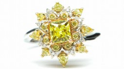 A 1.02ct Radiant Shaped Fancy Intense Yellow Diamond Set In A Combination Of 18K White and Yellow Gold Ring