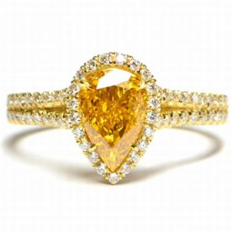A 1.34ct Pear Shape Fancy Intense Yellow Orange Diamond.