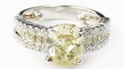 A 3.09ct Cushion Shaped Fancy Grayish-Greenish-Yellow Diamond Set In 18K White Gold Ring