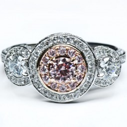 A 0.31ct Round Shaped Fancy Pink Diamond Set In 18K White Gold Ring