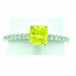 A1.15ct Radiant Cut Fancy Vivid Yellow Diamond Set In A Platinum Ring