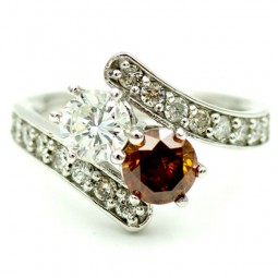 A 0.70ct Round Brilliant I-SI1 and a 0.87ct Round Brilliant Fancy Deep brownish Orange Set in a White Gold 14Kt Ring